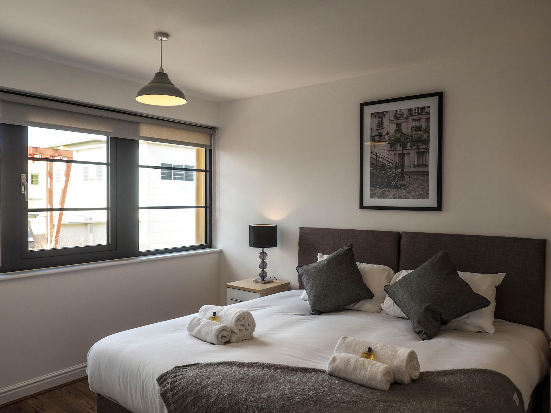 Bright bedroom at Wessex Court Serviced Apartment