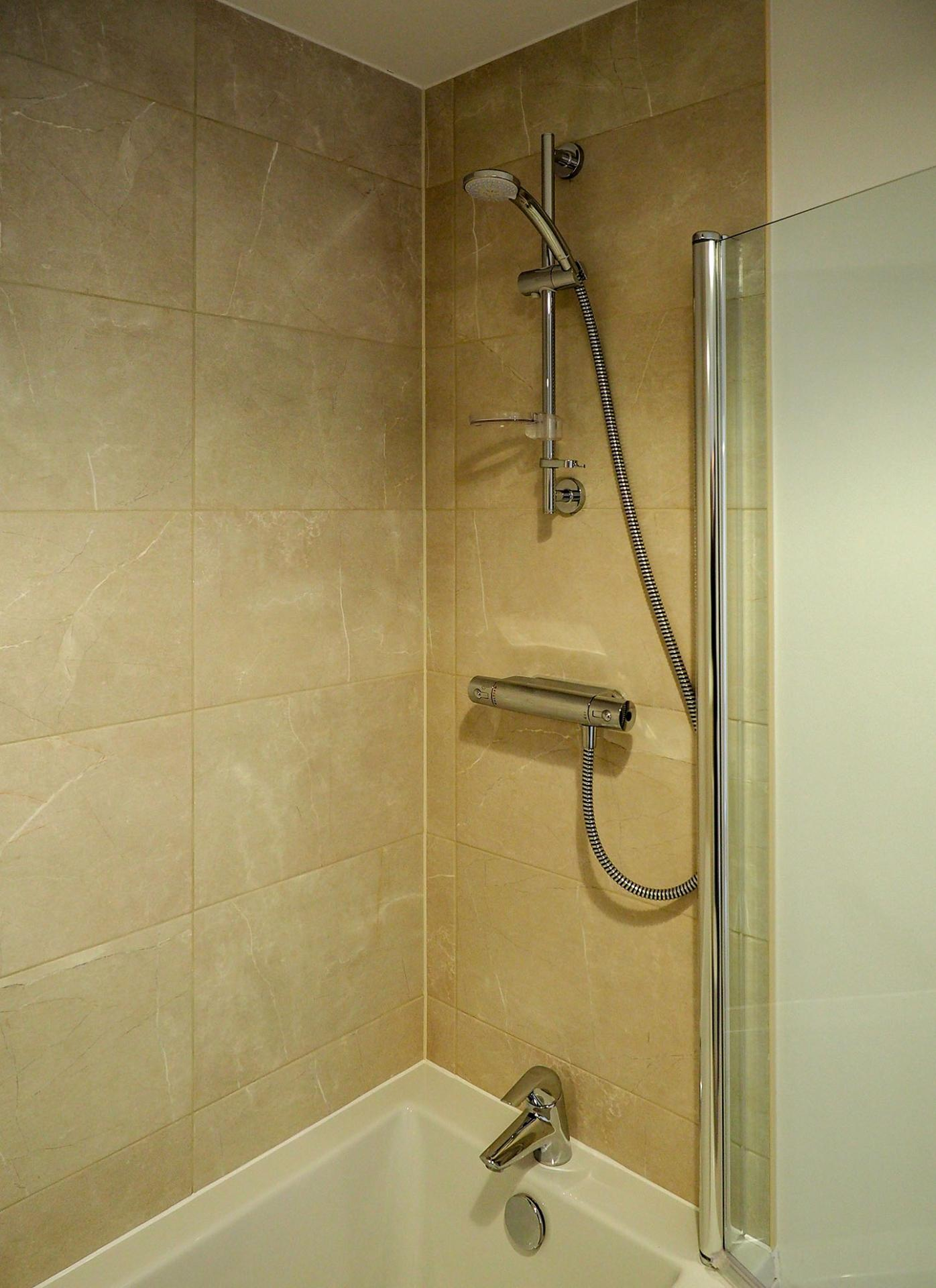 Shower at Wessex Court Serviced Apartment