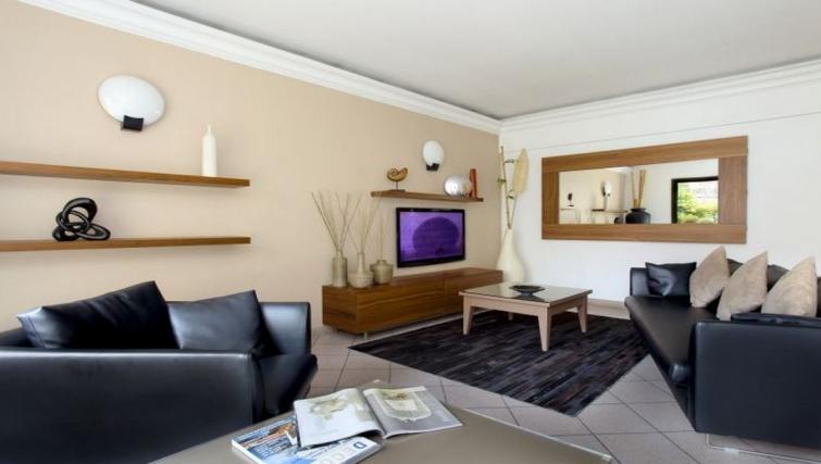 Comfortable living area in Citadines Castellane Apartments