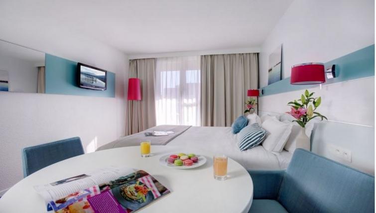 Modern bedroom in Citadines Castellane Apartments