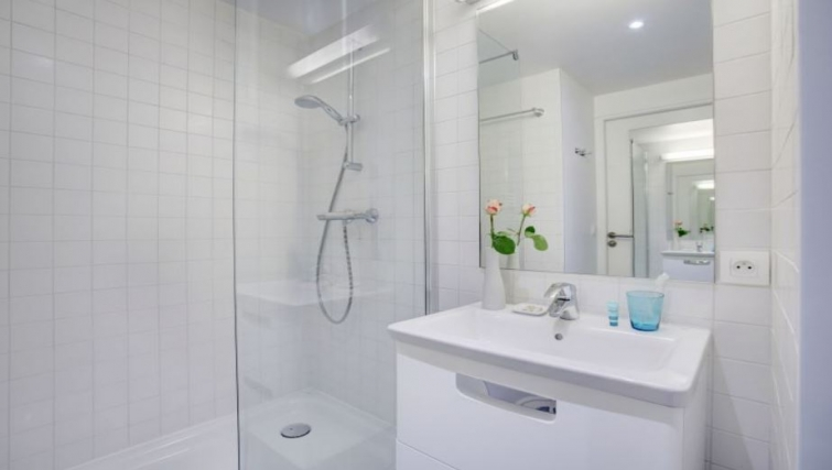 Simple bathroom in Citadines Castellane Apartments