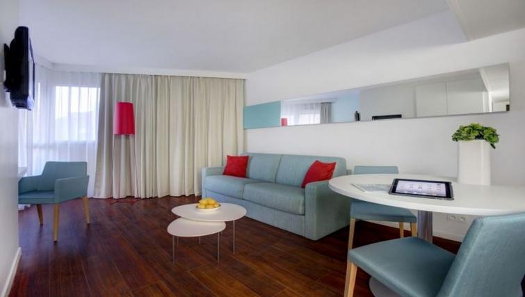 Contemporary living area in Citadines Castellane Apartments