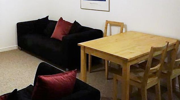 Living room at The Coach House Serviced Apartment
