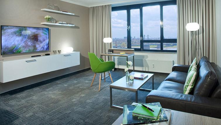 Open plam living area at Lindner Messe Residence Dusseldorf
