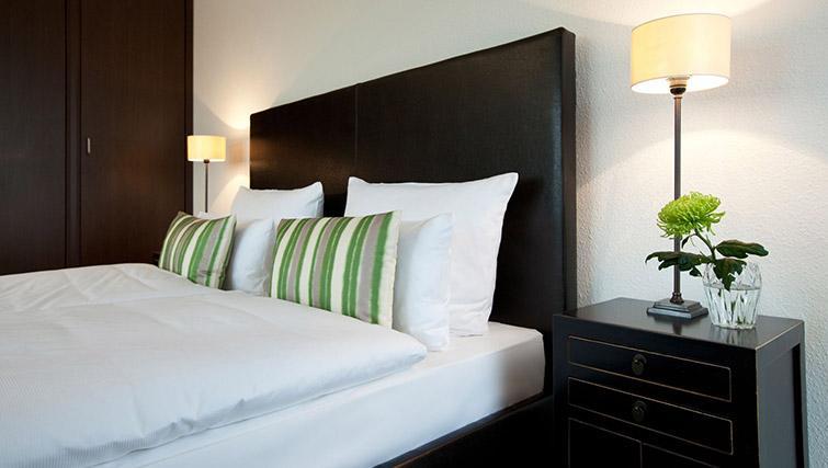 Comfy bed at Lindner Messe Residence Dusseldorf