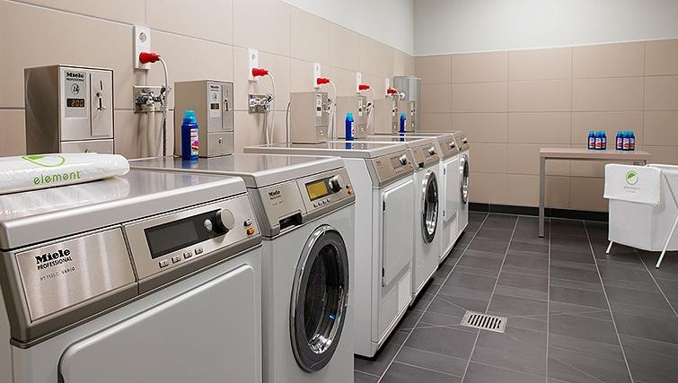 Communal laundry at Element Frankfurt Airport Apartments