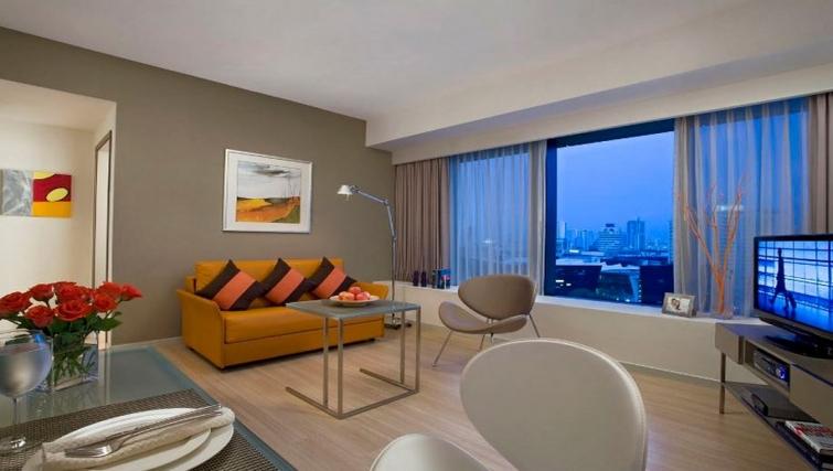 Living area in Citadines Mount Sophia Apartments, Singapore