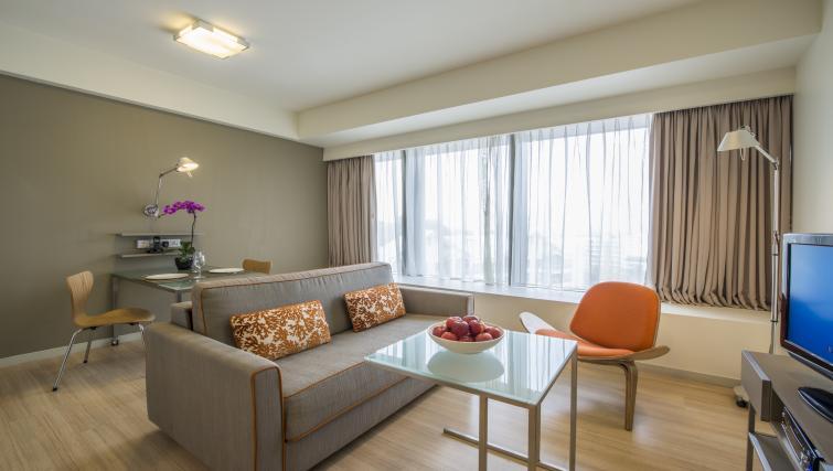 Bright living area at Citadines Mount Sophia Apartments, Singapore