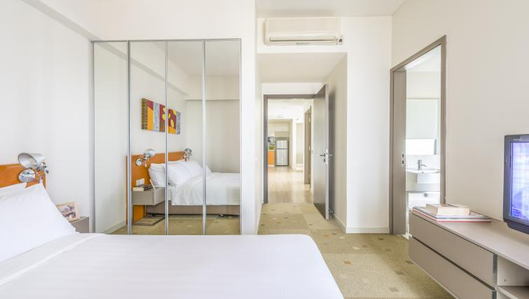 Spacious bedroom at Living space at Citadines Mount Sophia Apartments, Singapore
