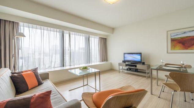 Bright living room at Citadines Mount Sophia Apartments, Singapore