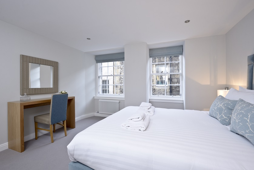 Bright bedroom at New Town Serviced Apartments