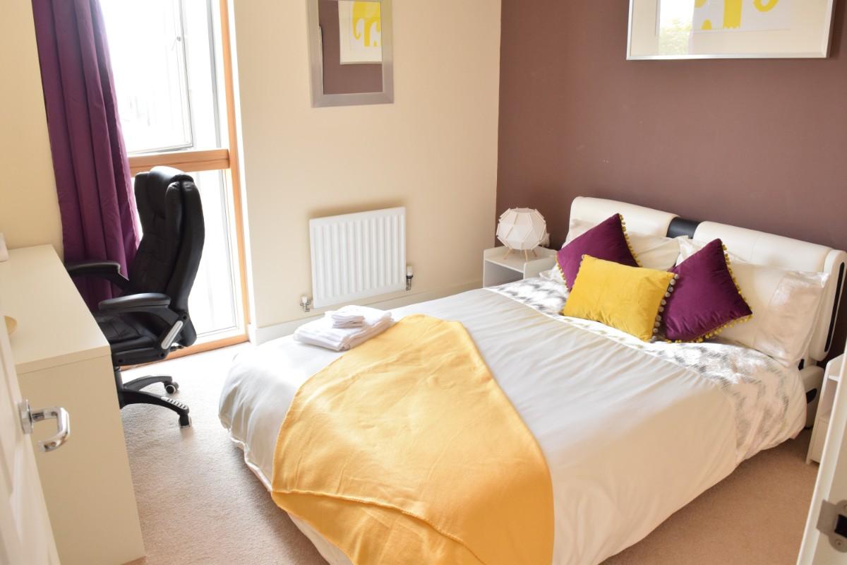 Bedroom at Dazzon Apartments