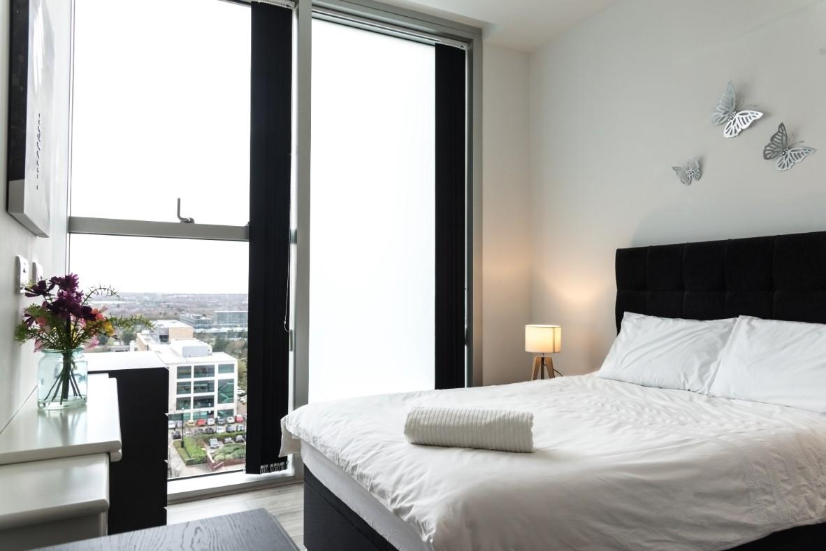 Bright bedroom at Dazzon Apartments