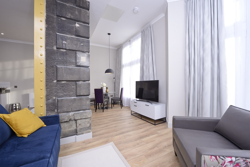Bright living area at Charlotte Square Apartments