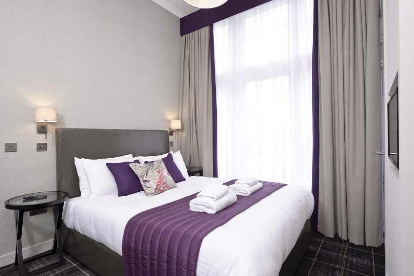 Bright bedroom at Charlotte Square Apartments