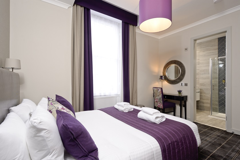Stylish bedroom at Charlotte Square Apartments