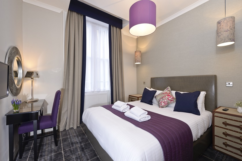 Cosy bedroom at Charlotte Square Apartments