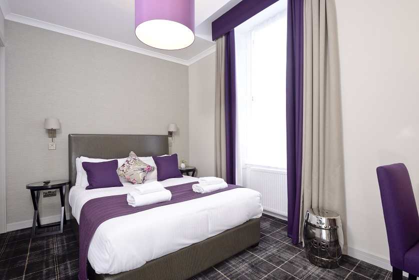 Double bed at Charlotte Square Apartments