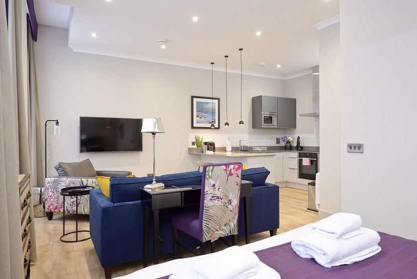 Contemporary living area at Charlotte Square Apartments