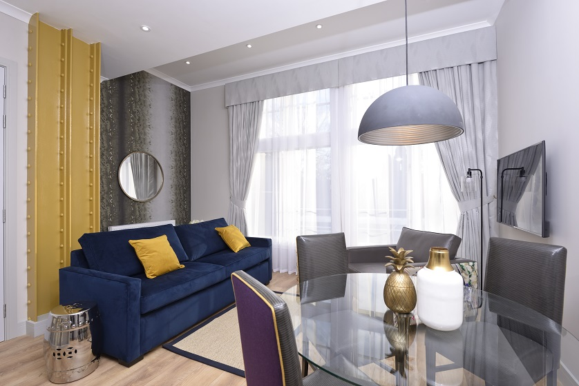 Stylish living room at Charlotte Square Apartments