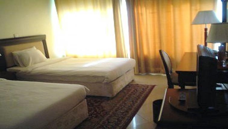 Bright bedroom in Al Dafna Apartments