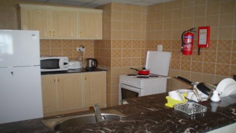 Functional kitchen in Al Dafna Apartments
