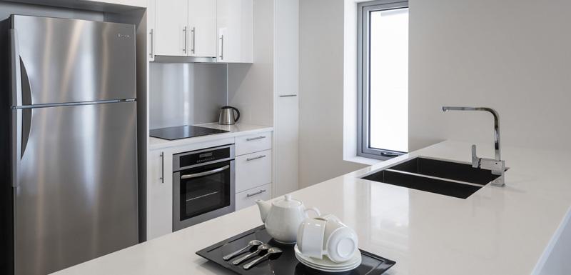 Kitchen area at Oaks Darwin Elan Hotel Apartments