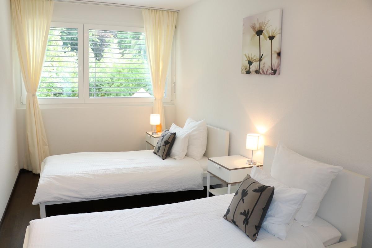 Twin beds at Paderewski 26 Apartments