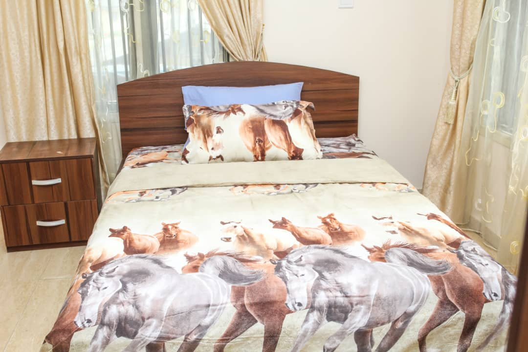 Comfortable bed at SSCFG Apartments and Suites