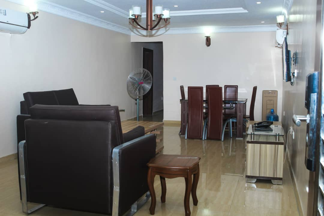 Living room at SSCFG Apartments and Suites