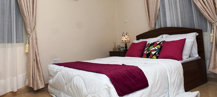 Bedroom at SSCFG Apartments and Suites