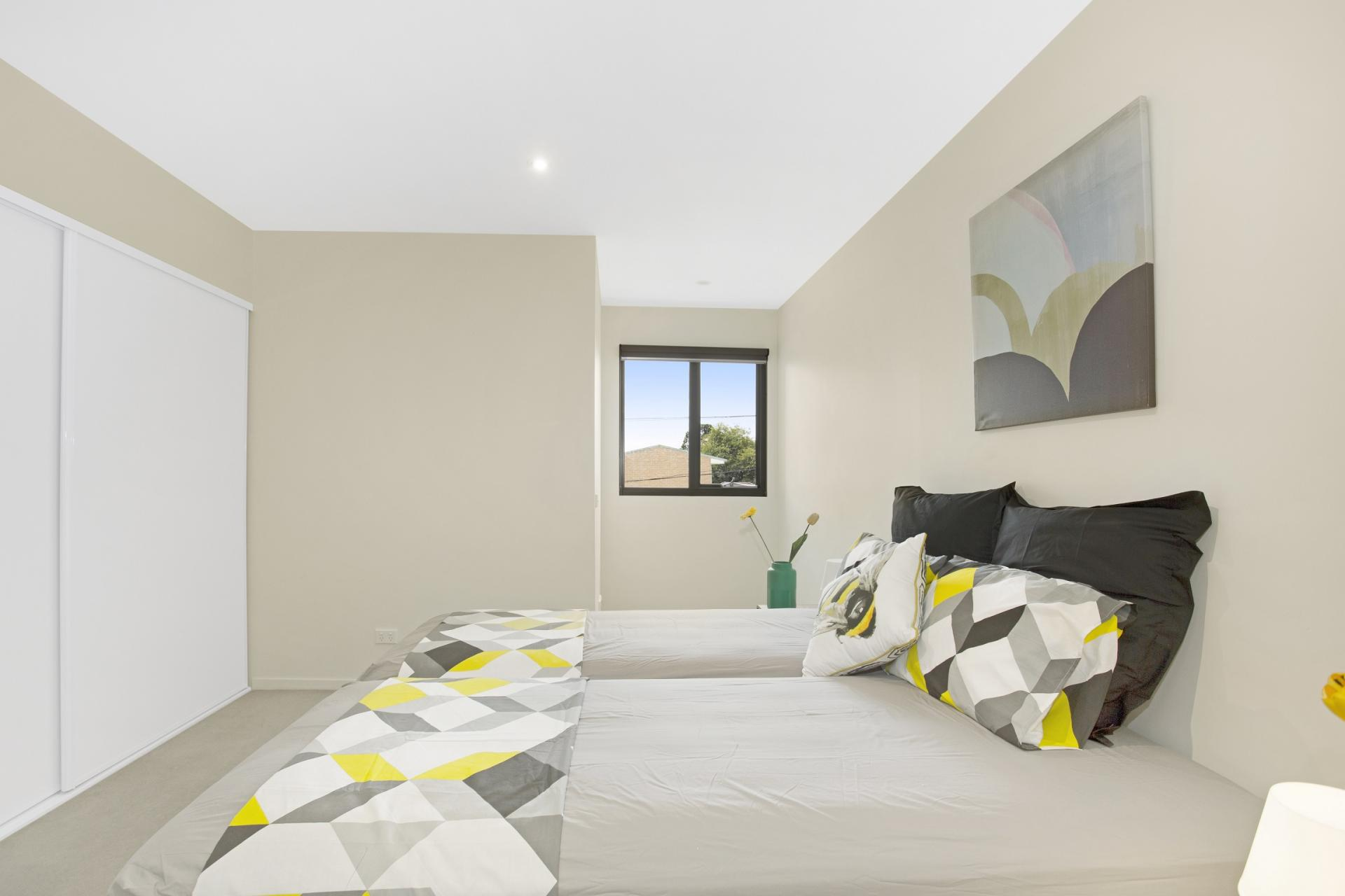 Twin beds at Glen Waverley Apartments
