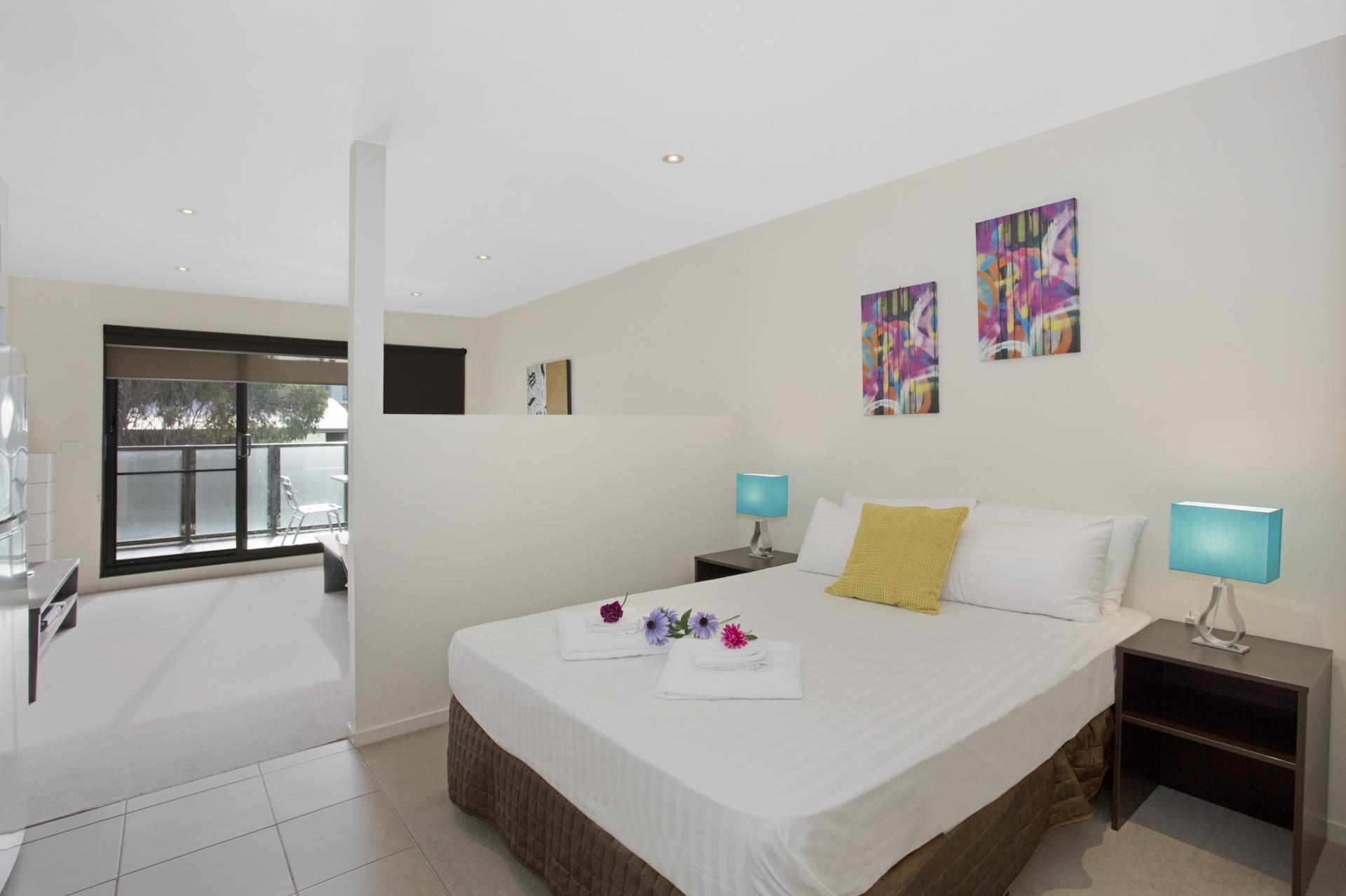 Double bed at Glen Waverley Apartments