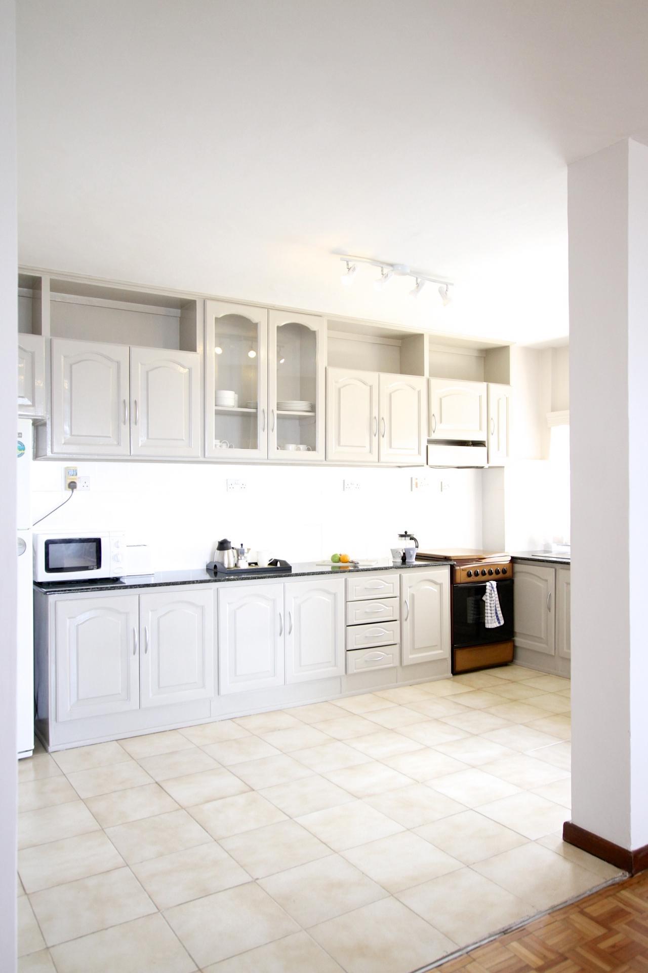 Kitchen at Yaya Apartments