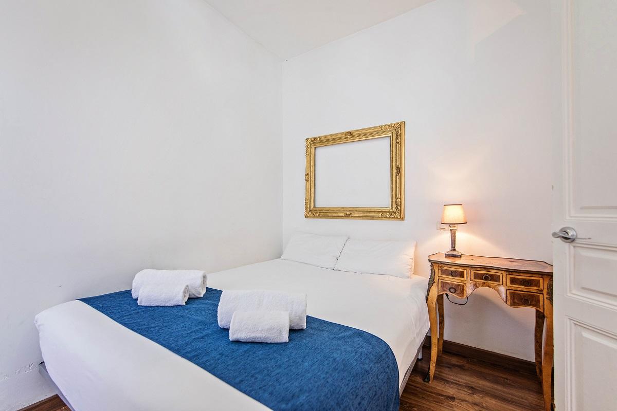Bedroom at Comte Urgell Apartment