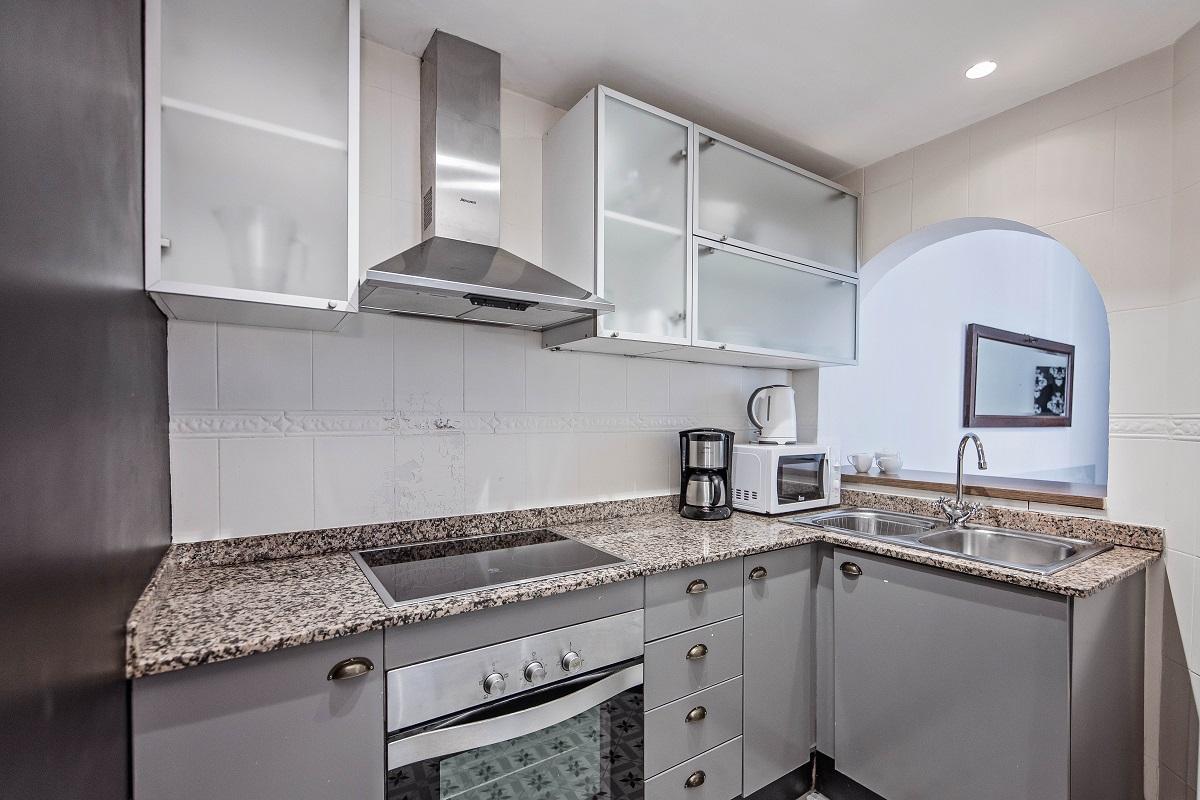 Kitchen at Comte Urgell Apartment