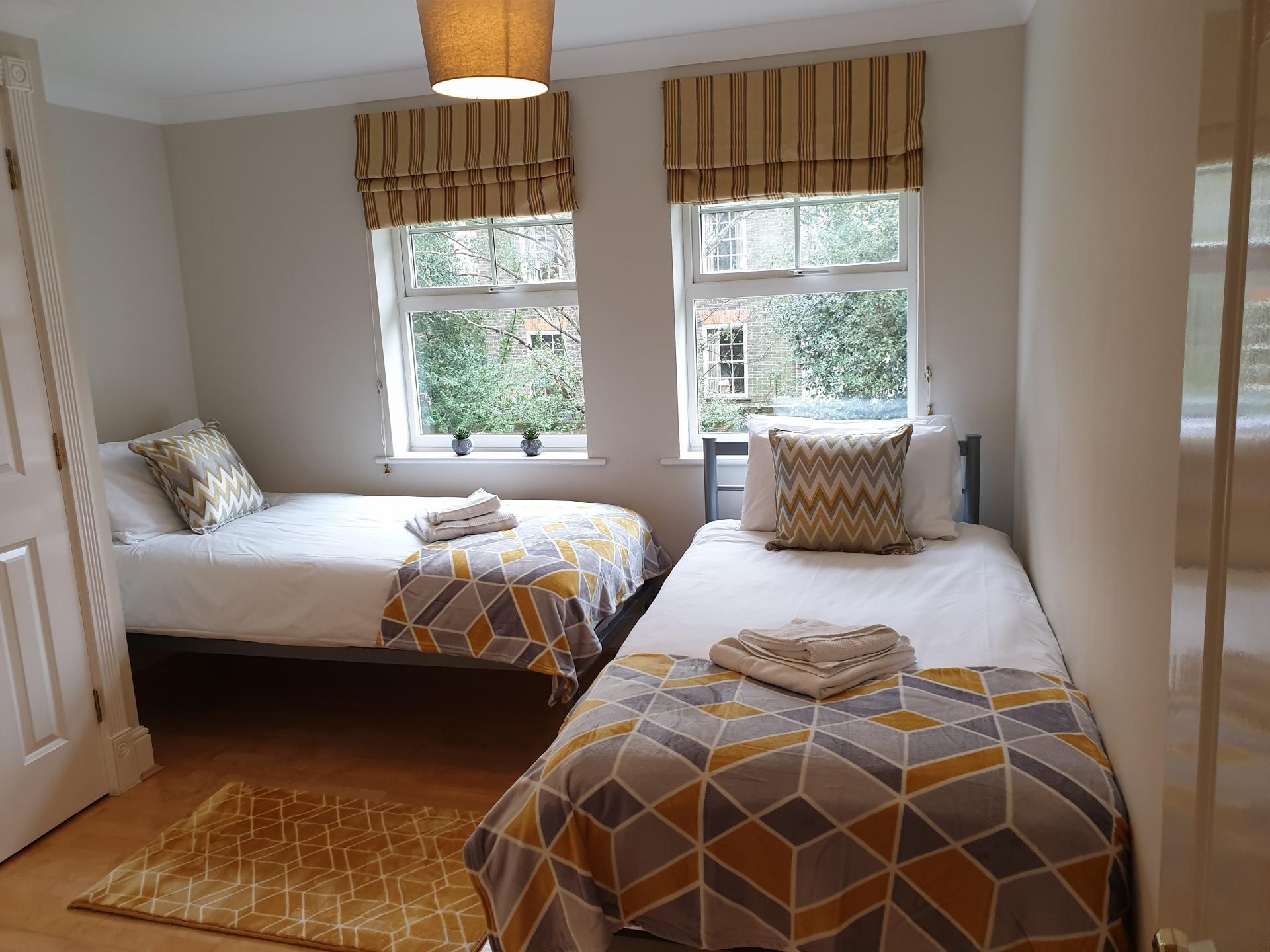 Twin beds at Alexander La Roche Court Apartments, Richmond, London