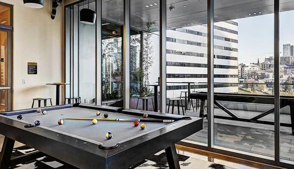 Game room at AMLI Arc Corporate Housing