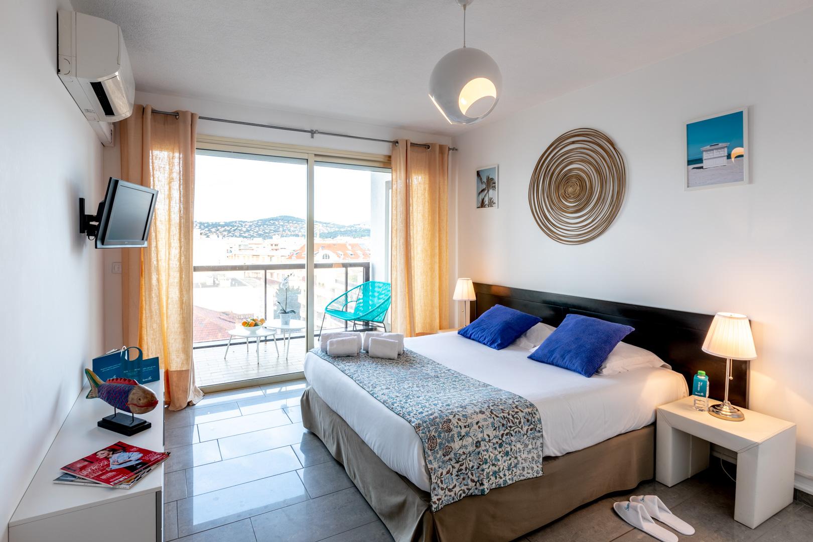 Cosy bed at Avenue Alexandre Apartments, Juan-les-Pins, Antibes
