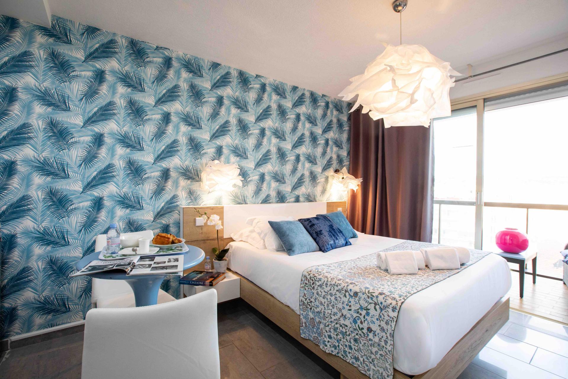 Bright bedroom at Avenue Alexandre Apartments, Juan-les-Pins, Antibes
