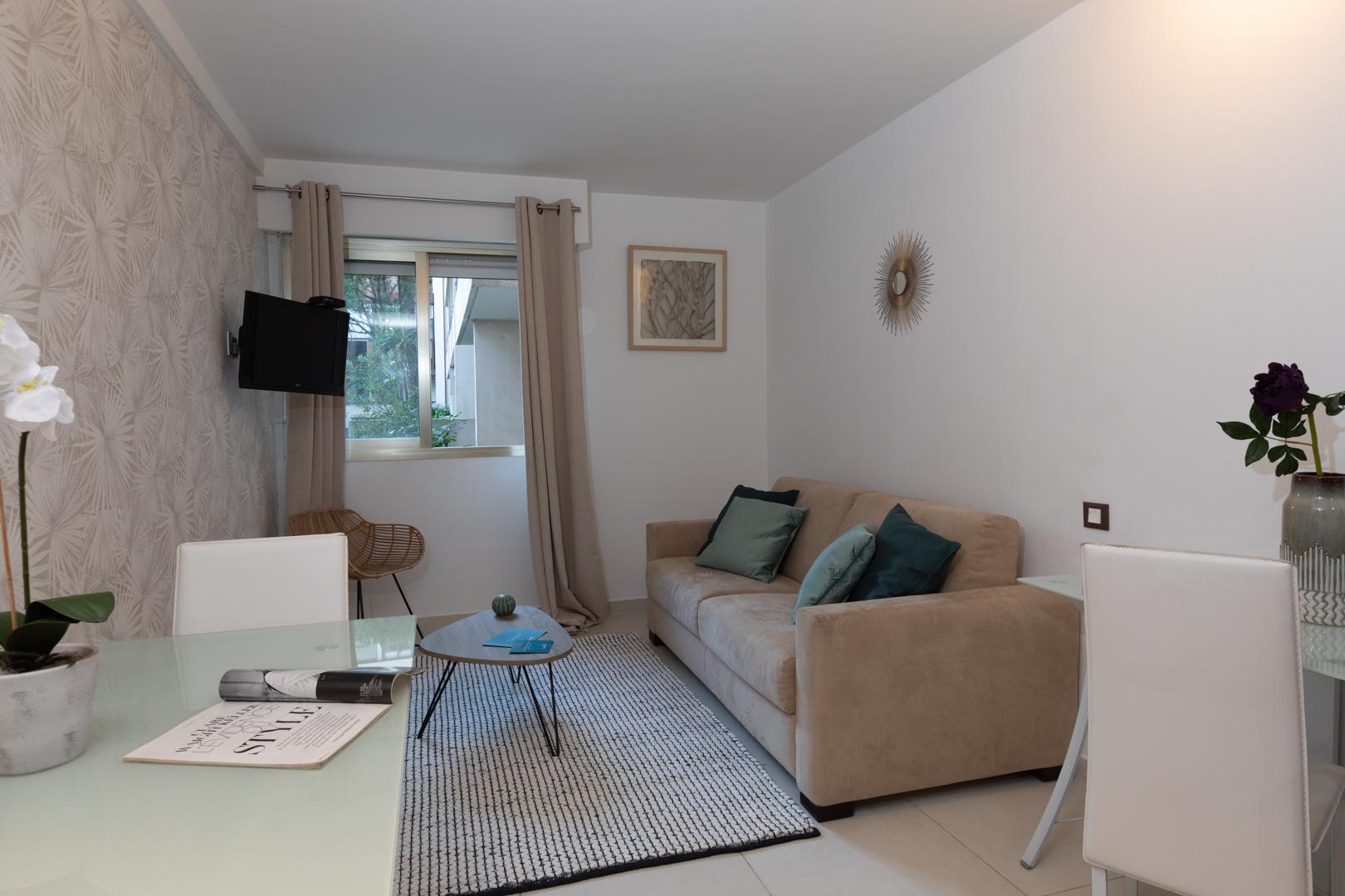 Neutral living area at Avenue Alexandre Apartments, Juan-les-Pins, Antibes