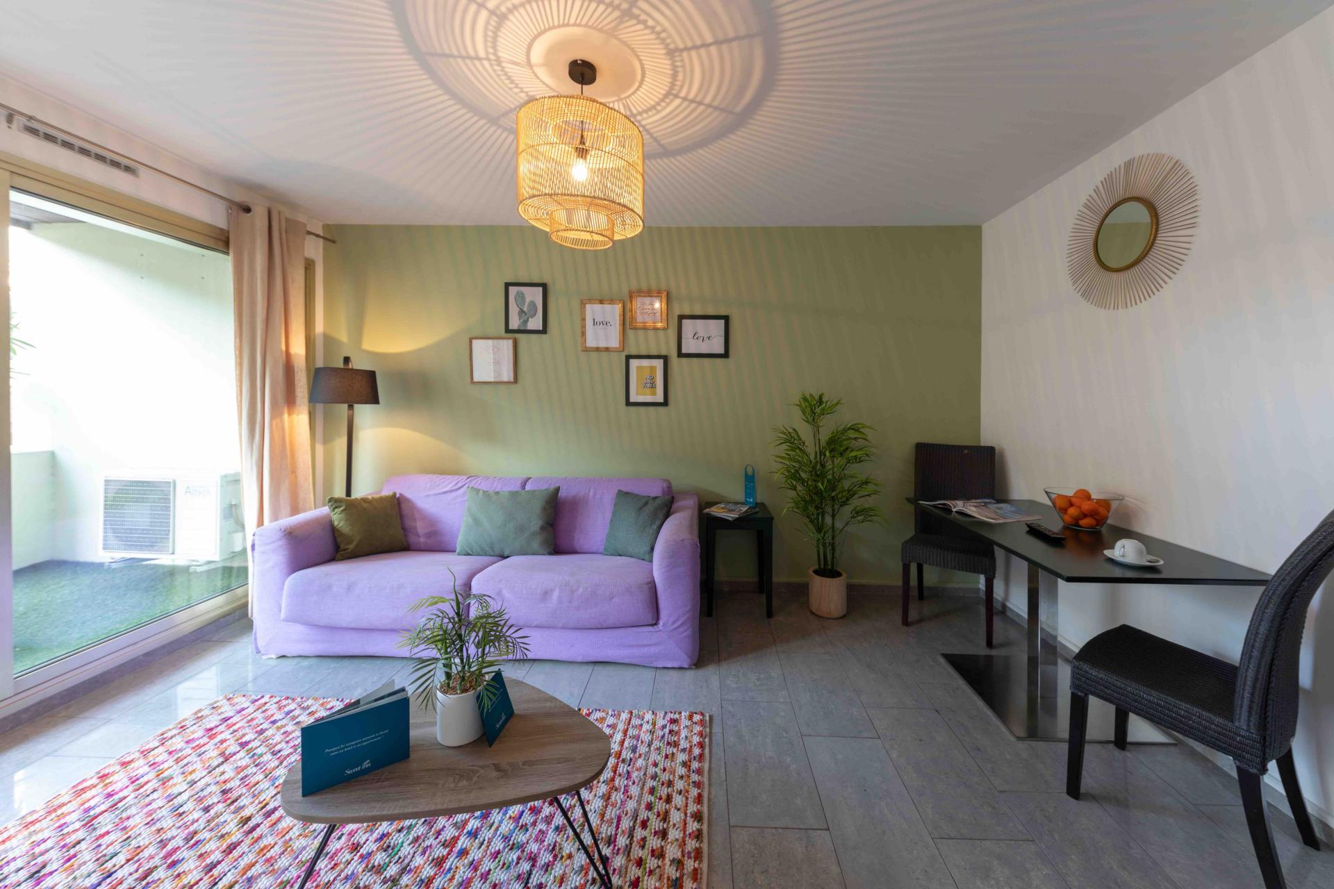 Pink sofa at Avenue Alexandre Apartments, Juan-les-Pins, Antibes