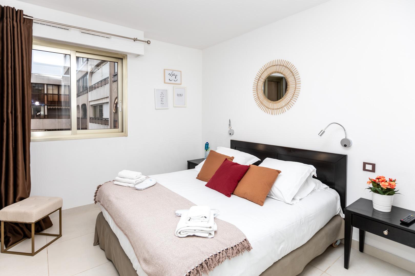 Neutral bedroom at Avenue Alexandre Apartments, Juan-les-Pins, Antibes