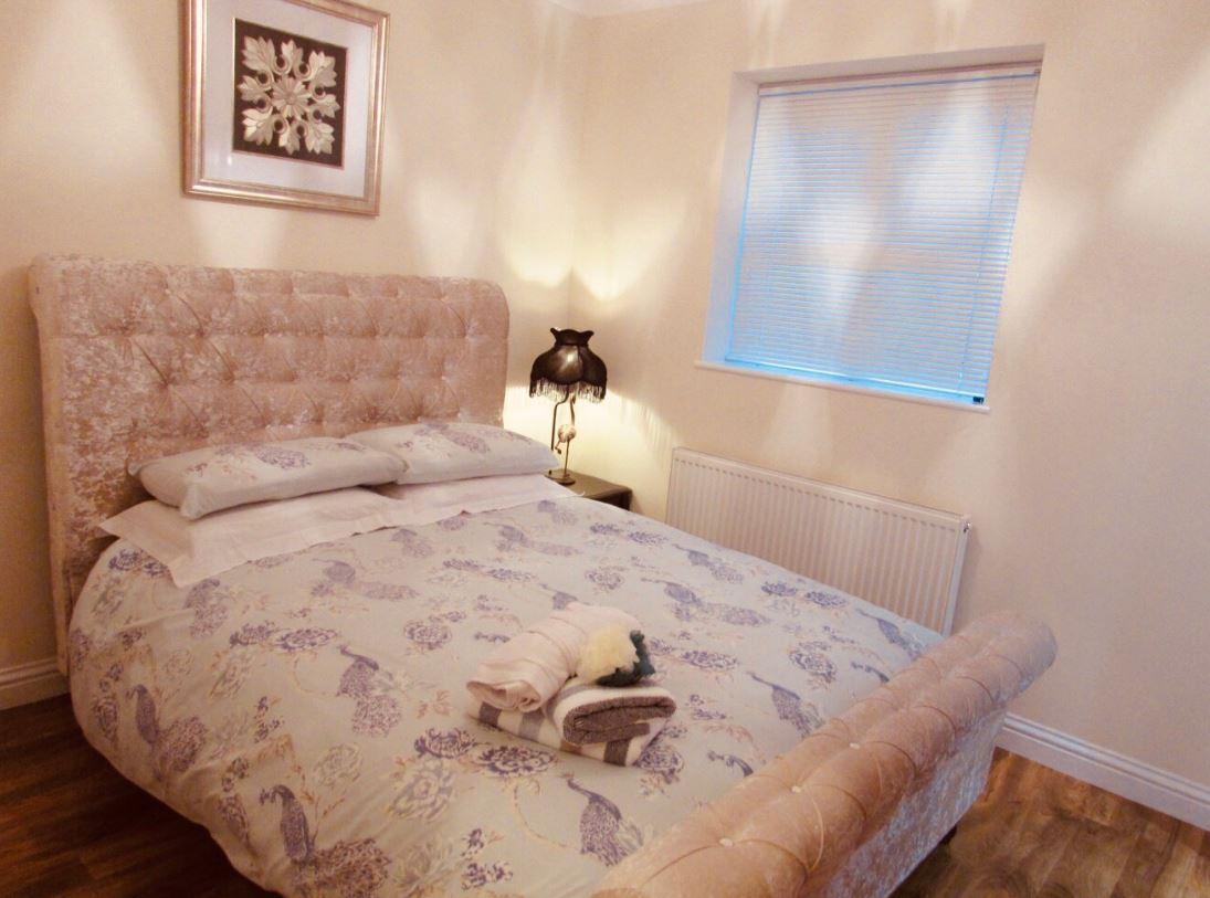 Comfortable bed at The Apartments at Yarm Road