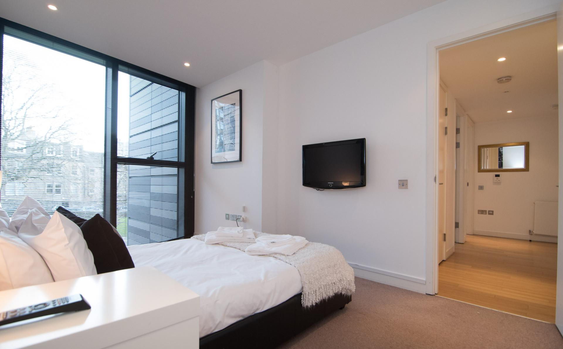 Bright bedroom at Simpson Loan Apartments