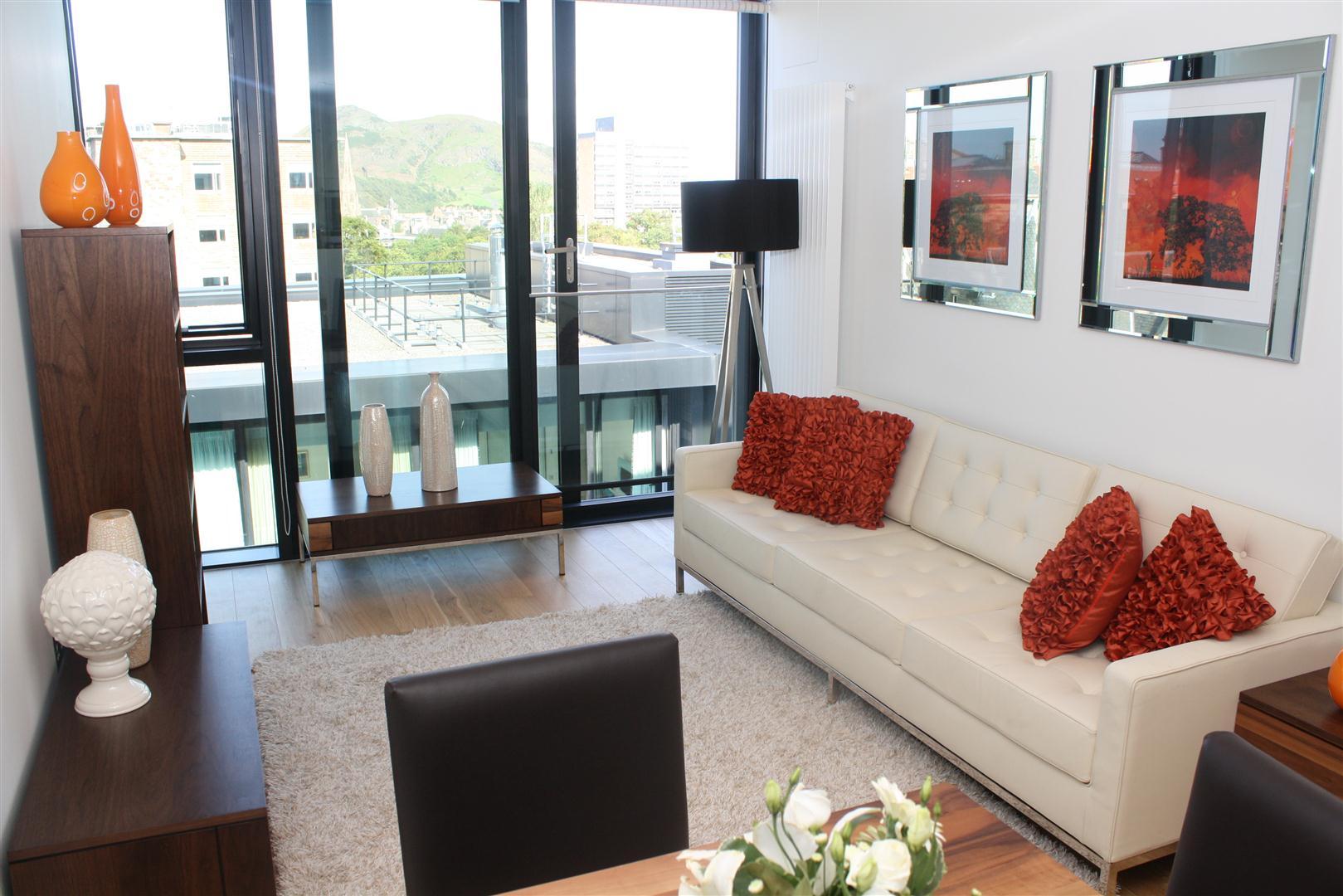 White sofa at Simpson Loan Apartments