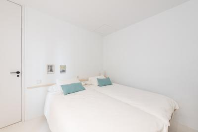 Twin beds at Delicias Apartment