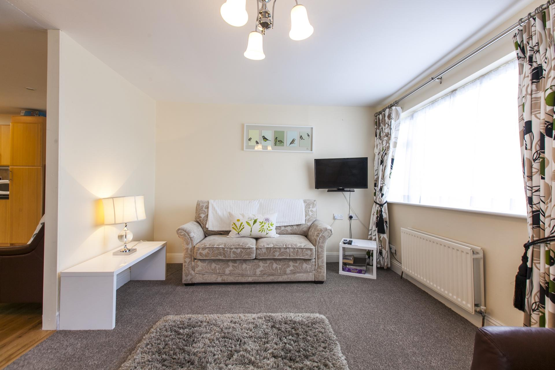 Bright living area at Tyrconnell Road Apartments