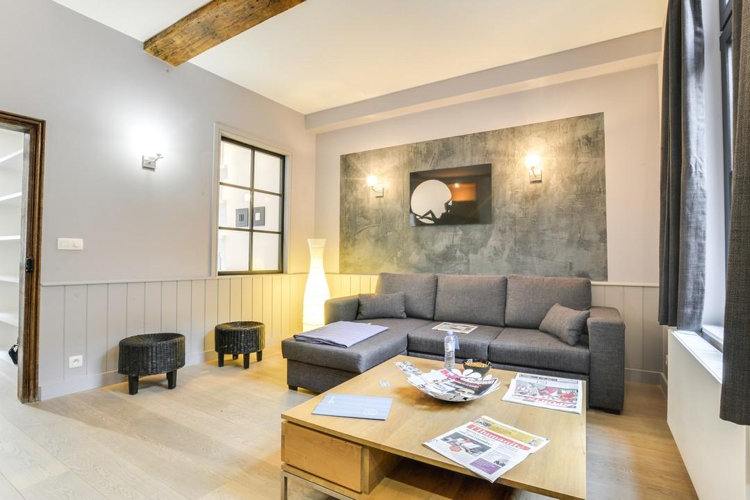 Sofa at Sablons Apartment