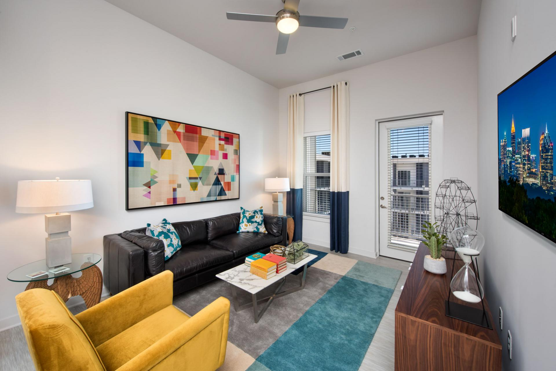 Living Room at Spectrum on Spring Apartment